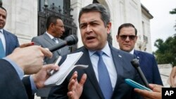 Honduran PHonduran President Juan Orlando Hernandez answers questions from the Associaresident Juan Orlando Hernandez answers questions from the Associated Press, Aug. 13, 2019, as he leaves a meeting at the Organization of American States, in Washington.