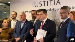 Judges of the Iustitia association release a report listing dozens of judges and prosecutors who are facing reprisals for questioning changes the right-wing government is making to the court system, in Warsaw, Poland, Feb. 29, 2020.