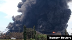 Smoke rises during a fire at Pertamina's oil refinery in Balongan, Indramayu regency
