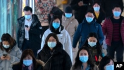 Commuters wearing face masks to protect against the spread of the coronavirus walk through a subway station in Beijing, Wednesday, March 3, 2021. China has been regularly reporting no locally transmitted cases of COVID-19 as it works to maintain…