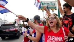 FILE - Cuban exiles rally at Versailles Restaurant in Miami's Little Havana neighborhood in support of protesters in Cuba, July 12, 2021, in Miami.