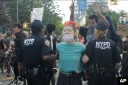 Protesters arrest a protestor during a rally at the Barclays Center over the death of George Floyd, a black man who was in police custody in Minneapolis Friday, May 29, 2020, in the Brooklyn borough of New York.