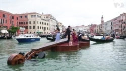 String Quartet Plays Vivaldi on Giant Violin Floating Down Venice Canal