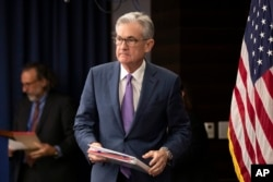 FILE - Federal Reserve Chairman Jerome Powell walks to the podium during a news conference in Washington, July 31, 2019.