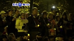 VOA60 America - Thousands gather at a vigil honoring those who died in a warehouse fire in Oakland
