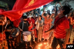 People take part in a noise campaign on the street after calls for protest against the military coup emerged on social media, in Yangon, Myanmar, on Feb. 5, 2021.