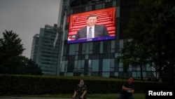 A screen at a department store shows Chinese President Xi Jinping during the opening session of the Chinese People's Political Consultative Conference (CPPCC) at the Great Hall of the People in Beijing, China, May 21, 2020.