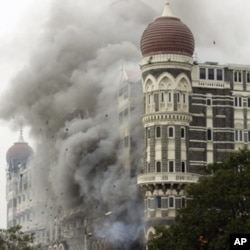 FILE - In this Nov. 29, 2008 file picture, smoke billows from the landmark Taj Mahal hotel in Mumbai, India after an attack by gunmen.