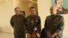 SDF general commander Mazlum Abdi, center, speaks during a press conference in Kobani, Syria, July 22, 2019. (S. Kajjo/VOA video grab)