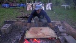 Fire Painting Artist Burns His Art