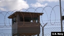 FILE - A soldier stands guard in a tower at Camp Delta at Joint Task Force Guantanamo Bay. (US Army photo)