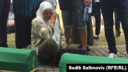 Srebrenica - Bosnia and Herzegovina - Mevlida Aljić is saying goodbye to her brother Jusuf Aljić, who will be buried in the Potočari Memorial Center