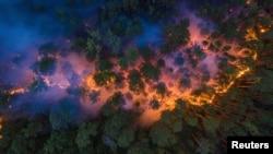 FILE - An aerial view shows a forest fire in Krasnoyarsk Region, in Siberia, Russia July 17, 2020. (Julia Petrenko/Greenpeace/Handout via Reuters)