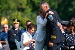 Speaker of the House Nancy Pelosi of California hugs Washington Metropolitan Police Department officer Michael Fanone, in the Rose Garden of the White House, Aug. 5, 2021.