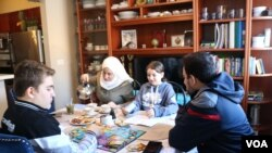 The Almadani family misses their native Syria, but have found a new life in the U.S. (K. Khan/VOA)
