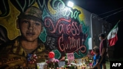 AUSTIN, TX - JULY 06: People pay respects at a mural of Vanessa Guillen, a soldier based at nearby Fort Hood on July 6, 2020 in Austin, Texas. A suspect in the disappearance of Guillen, whose remains were found in a shallow grave, faced a judge…