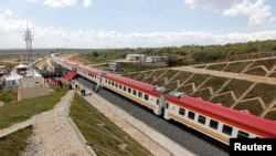 A general view shows a train on the Standard Gauge Railway line constructed by the China Road and Bridge Corporation and financed by Chinese government in Kenya, Oct. 16, 2019.