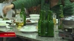 VOA 29/5/21: Người Việt ăn thịt, uống bia nhiều hơn dù thu nhập giảm