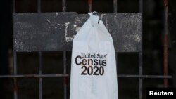 A packet from the U.S. Census 2020 hangs on a door amid the coronavirus disease (COVID-19) outbreak on Whidbey Island, Washington, U.S., March 21, 2020. REUTERS/Brian Snyder