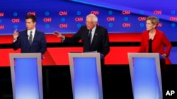 South Bend Mayor Pete Buttigieg, Sen. Bernie Sanders, I-Vt., and Sen. Elizabeth Warren, D-Mass., participate in the first of two Democratic presidential primary debates hosted by CNN, July 30, 2019, in the Fox Theatre in Detroit.