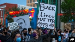 Demonstrators protest the death of George Floyd in downtown Albuquerque, N.M., May 31, 2020.