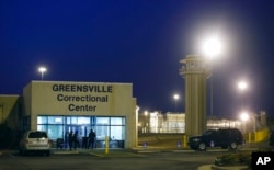 FILE - Guards stand outside the entrance to the Greensville Correctional Center, where executions are carried out, in Jarratt, Va., Sept. 23, 2010. Virginia lawmakers voted in February 2021 to end the death penalty.