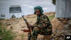 FILE - A fighter loyal to the Tigray People's Liberation Front mans a guard post on the outskirts of the town of Hawzen, then-controlled by the group but later re-taken by government forces, in the Tigray region of northern Ethiopia, May 7, 2021.