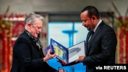 Ethiopian Prime Minister Abiy Ahmed Ali receives medal and diploma from Chair of the Nobel Comitteee Berit Reiss-Andersen during Nobel Peace Prize awarding ceremony in Oslo City Hall, Norway December 10, 2019. NTB Scanpix/Hakon Mosvold Larsen via…