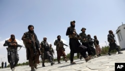 Taliban fighters patrol in Kabul, Afghanistan, Aug. 19, 2021.
