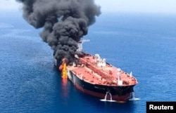 FILE - An oil tanker is seen after it was attacked at the Gulf of Oman, June 13, 2019.