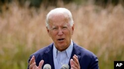 FILE - In this Sept. 14, 2020 file photo, Democratic presidential candidate and former Vice President Joe Biden speaks about climate change and wildfires affecting western states in Wilmington, Del. The United States is out of the Paris climate…