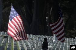 Nancy Graham visits San Francisco National Cemetery in the Presidio the day before Memorial Day in San Francisco, May 24, 2020.