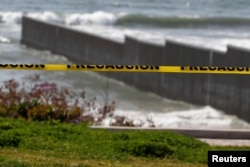 A police tape is seen near the beach and the Mexico-U.S. border fence, after municipal beaches are closed as part of social distancing measures to control the spread of the coronavirus in Tijuana, Mexico March 30, 2020.