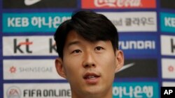 South Korean national soccer team player Son Heung-min answers a reporter's question upon his arrival after the soccer match against North Korea, at Incheon International Airport in Incheon, South Korea, Thursday, Oct. 17, 2019. North Korea held…