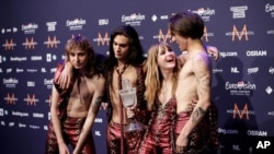 Members of the band Maneskin, from left, Thomas Raggi, Ethan Torchio, Victoria De Angelis and Damiano David pose with the trophy after winning the Grand Final of the Eurovision Song Contest in Rotterdam, Netherlands, May 22, 2021.