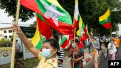 Military supporters wave Myanmar national flags during a protest to demand an inquiry to investigate the Union Election Commission (UEC) in Yangon on January 29, 2021, as fears swirl about a possible coup by the military over electoral fraud…