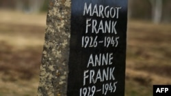 A memorial stone for Margot Frank and Anne Frank is pictured on the grounds of the former Prisoner of War (POW) and concentration camp Bergen-Belsen, March 18, 2020, near Lohheide, north of Hanover, central Germany.