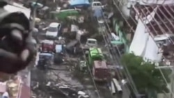 Nhân viên cứu trợ ở Philippines chật vật đến với nạn nhân bão