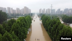 FILE - An aerial view shows a flooded road following heavy rainfall in Zhengzhou, Henan province, China, July 23, 2021.