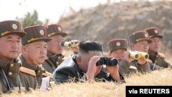 North Korean leader Kim Jong Un guides artillery fire competition in this image released by North Korea's Korean Central News Agency on March 20, 2020.