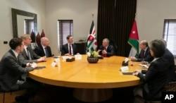 FILE - Presidential advisers Jared Kushner, center left, and Jason Greenblatt, third left, meet with Jordan's King Abdullah II, center right, and his advisers, in Amman, Jordan, May 29, 2019.