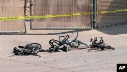 Damaged bikes can be seen in Show Low, Ariz., where a driver in a pickup truck plowed into bicyclists competing in a community road race, June 19, 2021. (White Mountain Independent photo)