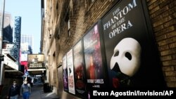 Posters from a Broadway show are displayed outside the Richard Rogers theater in New York during lockdown on May 13, 2020. (Photo: AP/Evan Agostini/Invision)