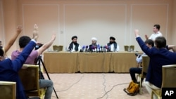 Members of political delegation from the Afghan Taliban's movement Dr, Mohammad Naim, left, Mawlawi Shahabuddin Dilawar, center, and Suhil Shaheen attend a news conference in Moscow, Russia, July 9, 2021.