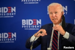 FILE - Joe Biden speaks at a campaign event devoted to the reopening of the U.S. economy during the coronavirus pandemic in Philadelphia, June 11, 2020.