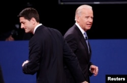FILE - Vice President Joe Biden (R) and Republican vice presidential nominee Paul Ryan depart at the conclusion of the vice presidential debate in Danville, Kentucky, Oct. 11, 2012.