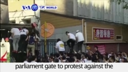 VOA60 World - Taiwan: Demonstrators pushed through parliament gate to protest against the legalization of same-sex marriage