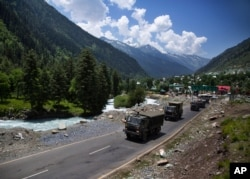 An Indian army convoy moves on the Srinagar- Ladakh highway at Gagangeer, north-east of Srinagar, India, June 17, 2020.