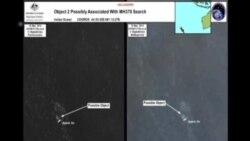 澳大利亞官員回答記者有關懷疑失蹤客機殘骸物體的提問
