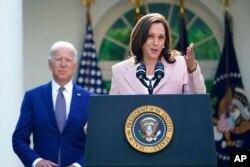 President Joe Biden listens to Vice President Kamala Harris speak in the Rose Garden of the White House, in Washington, Aug. 5, 2021.